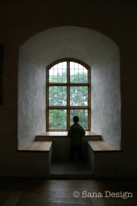 A Child watching through a Castle Window